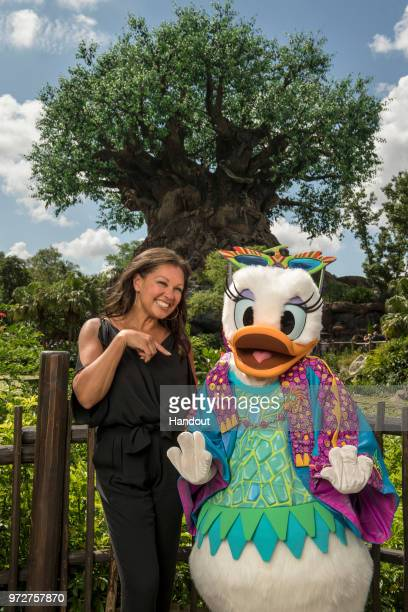 In this handout images provided by Walt Disney World Resort Actress singer and fashion designer Vanessa Williams poses with Daisy Duck donning her...