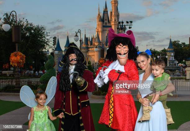 In this handout images provided by Walt Disney World Resort Puerto Rican singer and songwriter Lusi Fonsi his wife Agueda Lopez and their family...