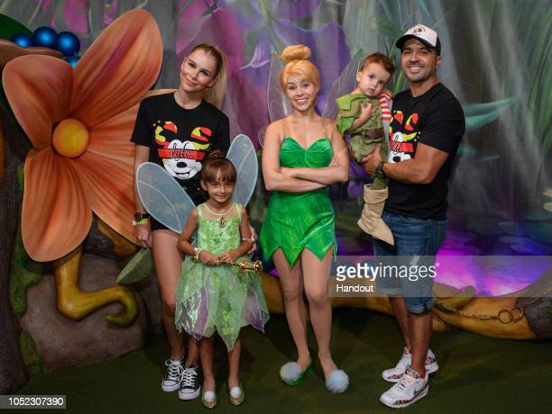 In this handout images provided by Walt Disney World Resort Puerto Rican singer and songwriter Luis Fonsi his wife Águeda Lopez and their family...