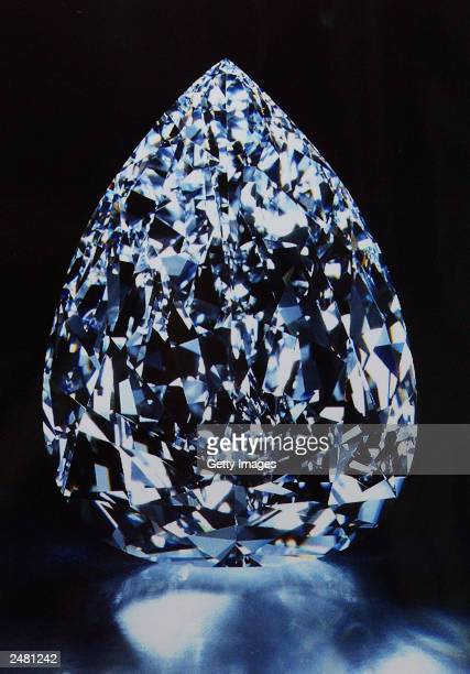 In this handout photo a De Beers 203 Carat diamond is seen on display This is the largest diamond in the world which is worth about $75000