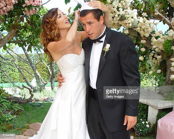 In this handout photo Adam Sandler poses with his bride modelactress Jackie Titone at their wedding June 22 2003 in Malibu California