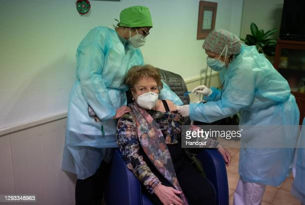 In this handout photo, An elderly woman receives one of the first Pfizer/BioNTech Covid-19 vaccines in Spain at the Somontano nursing home on 27...