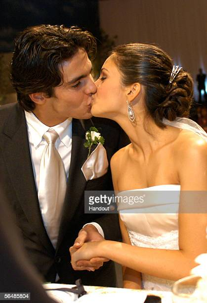 In this handout photo, Brazilian soccer star Kaka , who plays for Italian club AC Milan, kisses his bride Caroline Celico during their wedding in Sao...