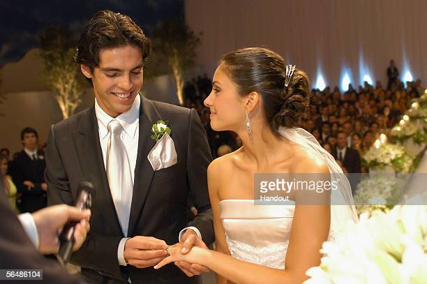 In this handout photo, Brazilian soccer star Kaka , who plays for Italian club AC Milan, poses with his bride Caroline Celico during their wedding in...