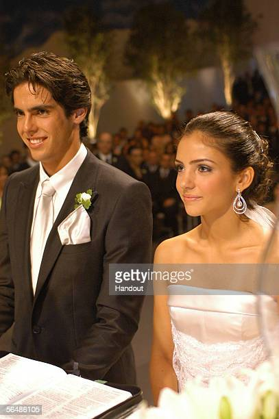 In this handout photo Brazilian soccer star Kaka who plays for Italian club AC Milan poses with his bride Caroline Celico during their wedding in Sao...