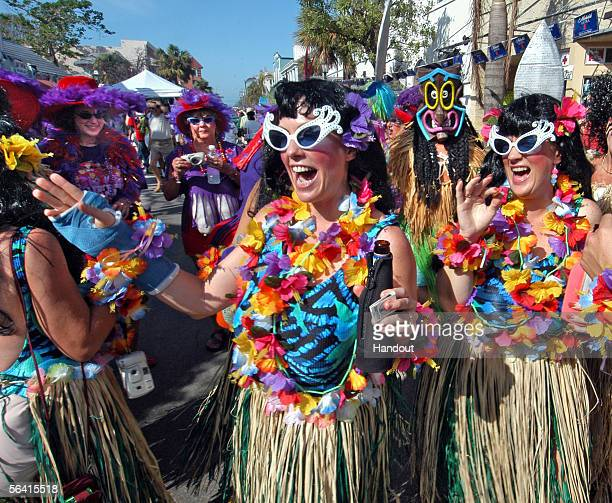 In this handout photo Carol Abend of Cudjoe Key Florida and her friends party on Duval Street during the Fantasy Fest Parade December 10 2005 in Key...