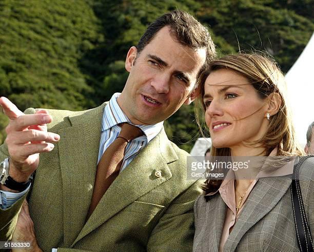 In this handout photo Crown Prince Felipe and Princess Letizia of Spain visit the rural village of Villar de Vildas chosen as the Best Asturian...