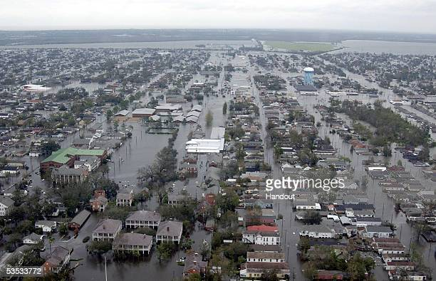 In this handout photo, Flooded neigborhoods can be seen as the Coast Guard conducts initial Hurricane Katrina damage assessment overflights August...