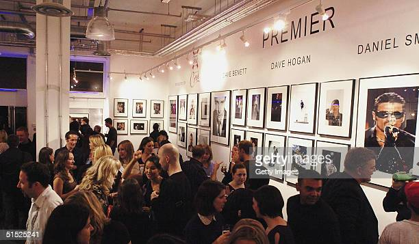 In this handout photo from Getty Images guests are seen attending the private view of the new 'Premier' exhibition displaying photographs from highly...