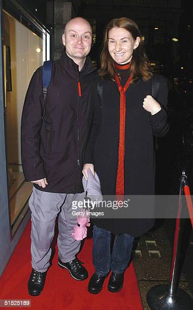 In this handout photo from Getty Images Julian Stockton is seen with an unidentifid guest at the private view of the new 'Premier' exhibition...