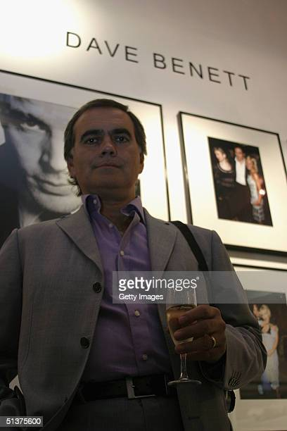"""In this handout photo from Getty Images, photographer Dave Benett is seen at the private view of the new """"Premier"""" exhibition, displaying photographs..."""