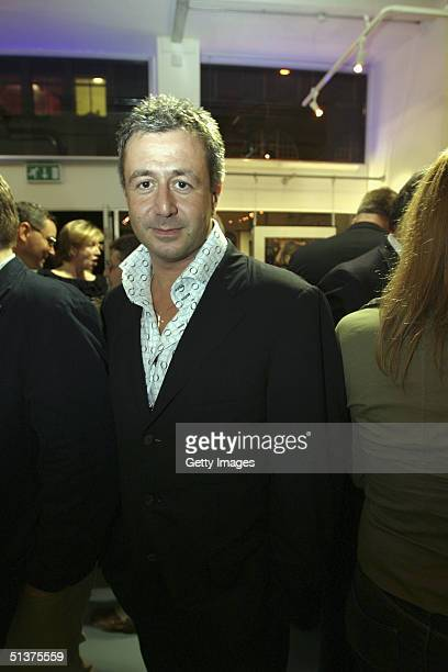 In this handout photo from Getty Images photographer Jason Fraser is seen at the private view of the new 'Premier' exhibition displaying photographs...