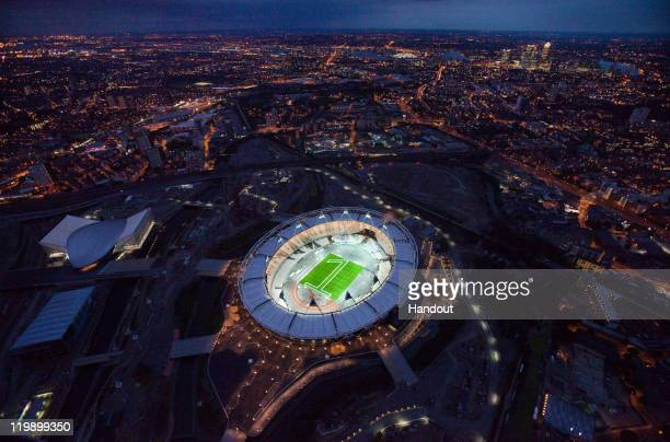 In this handout photo from LOCOG the London 2012 Olympic Stadium is illuminated to mark '1 year to go to the Olympic Games' These exclusive photos...