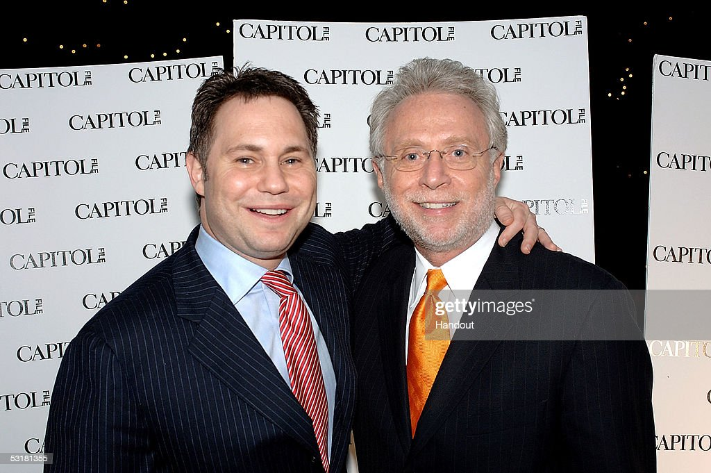 In this handout photo from Niche Media, Publisher Jason Binn (L) and News Anchor Wolf Blitzer attend Niche Media's Capitol File Magazine Pre-Launch Party on June 29, 2005 in Washington, DC.