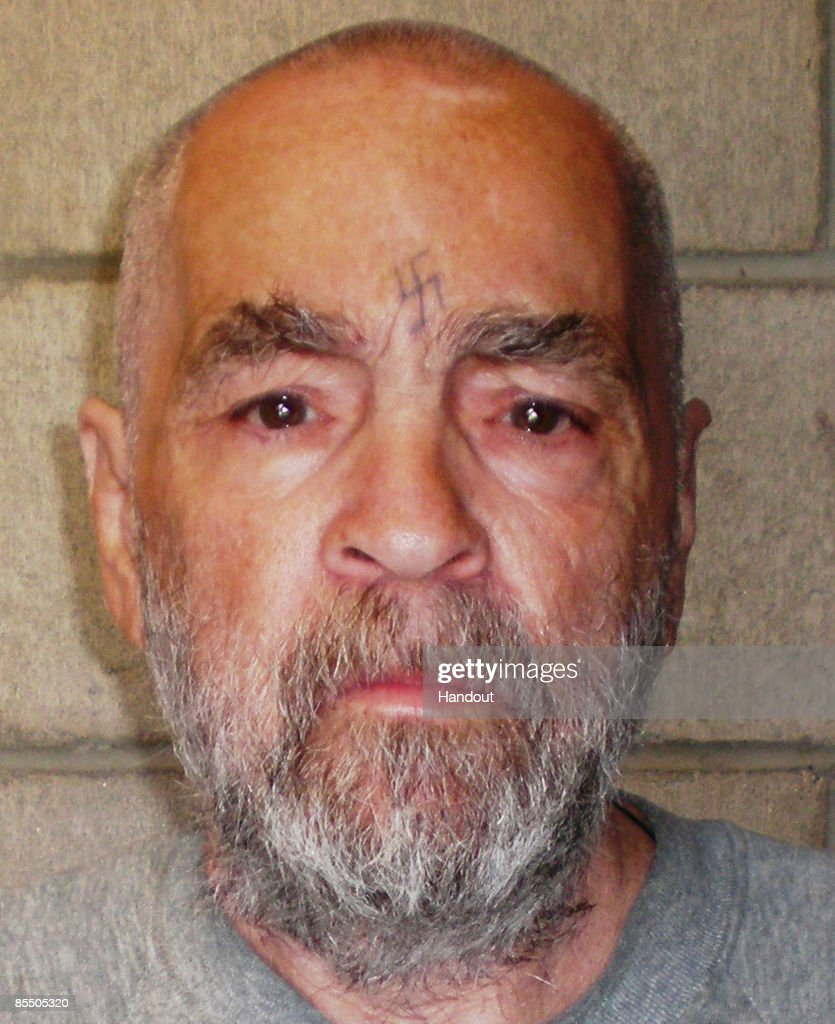 In this handout photo from the California Department of Corrections and Rehabilitation, Charles Manson, 74, poses for a photo on March 18, 2009 at Corcoran State Prison, California. Manson is serving a life sentence for conspiring to murder seven people during the 'Manson family' killings in 1969. The picture was taken as a regular update of the prison's files.