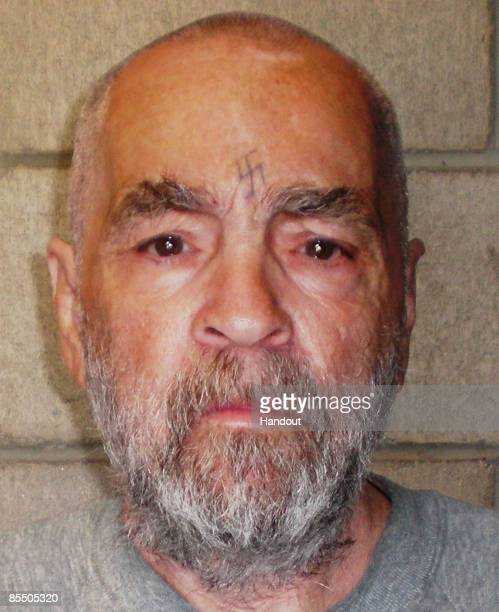 In this handout photo from the California Department of Corrections and Rehabilitation Charles Manson poses for a photo on March 18 2009 at Corcoran...