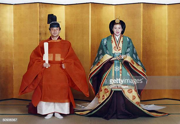 In this handout photo from the Imperial Household Agency Crown Prince Naruhito of Japan and his future wife Masako Owada pose for photographs in...