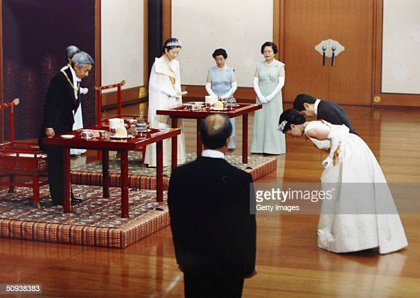 In this handout photo from the Imperial Household Agency, Crown Prince Naruhito of Japan and his wife Crown Princess Masako bow to Emperor Akihito...