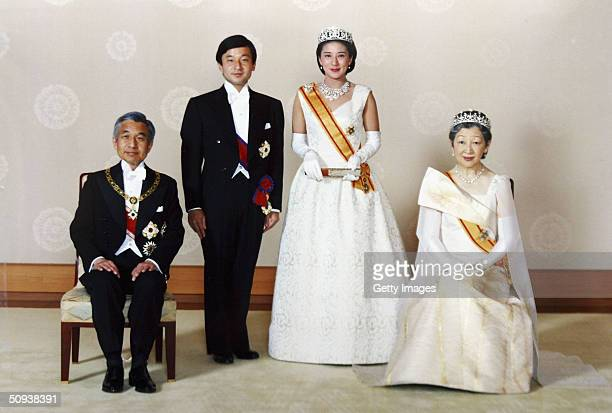 In this handout photo from the Imperial Household Agency, Crown Prince Naruhito of Japan and his wife Crown Princess Masako pose with Emperor Akihito...