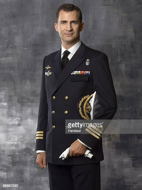 In this handout photo from the Spanish Royal Household Prince Felipe of Spain poses dressed in Frigate Capitain uniform during an official portrait...