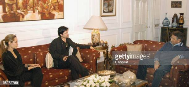 In this Handout photo from the United Nations UN Goodwill Ambassador Angelina Jolie and Hollywood Actor Brad Pitt visit President General Pervez...