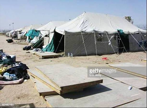 In this handout photo from the US Army released March 26 a tent is seen covering the entrance of a tunnel that was dug leading out of the Camp Bucca...