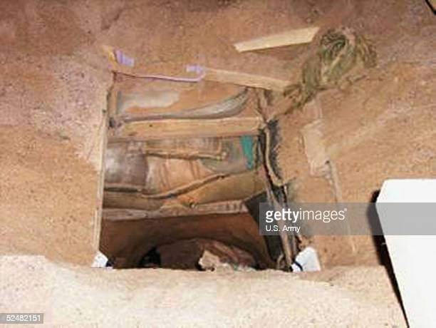 In this handout photo from the US Army released March 26 the inside of a tunnel that was dug leading out of the Camp Bucca detention facitlity near...