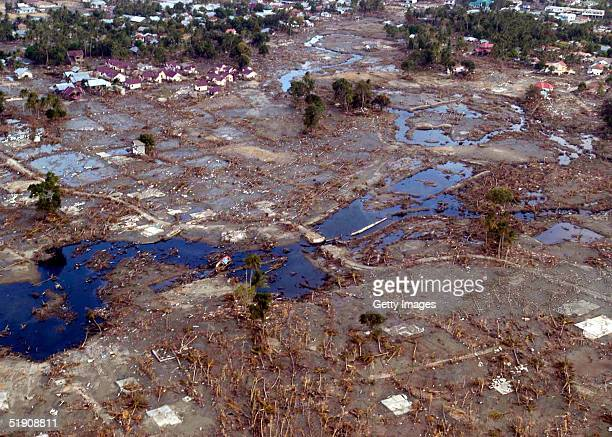 In this handout photo from the U.S. Navy, a view of the landscape after the tsunami swept through over Banda Aceh on January 1, 2005 in Sumatra,...