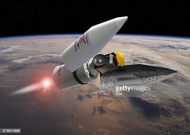 In this handout photo illustration provided by the European Space Agency the payload fairing seperates during the ExoMars 2016 launch sequence the...