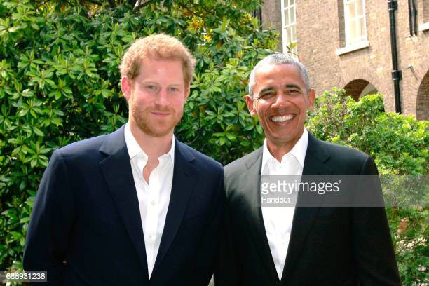 In this handout photo issued by Kensington Palace Prince Harry poses with former US President Barack Obama following a meeting at Kensington Palace...