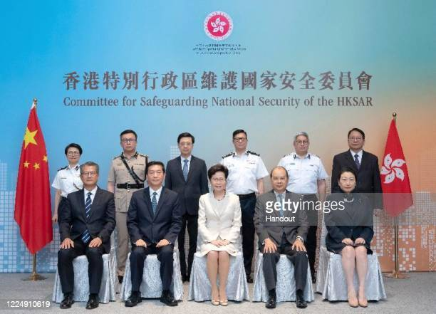 In this handout photo issued by the Hong Kong Information Services Department, Hong Kong Chief Executive Carrie Lam, Hong Kong National Security...