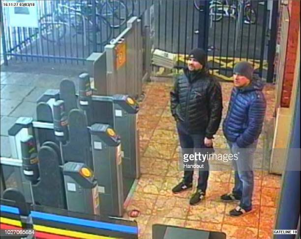 In this handout photo issued by the Metropolitan Police Salisbury Novichok poisoning suspects Alexander Petrov and Ruslan Boshirov are shown on CCTV...