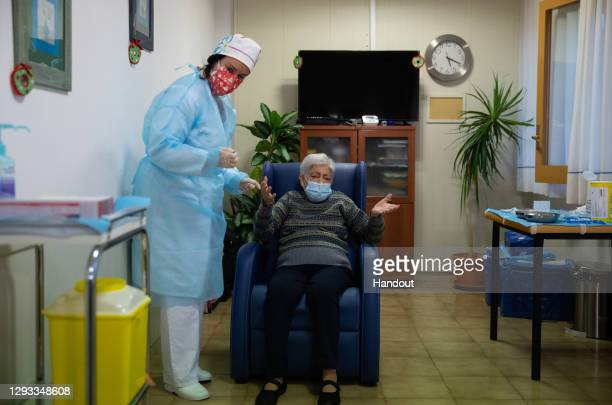 In this handout photo, Lidia Navarro after receiving one of the first Pfizer/BioNTech Covid-19 vaccines in Spain at the Somontano nursing home on...