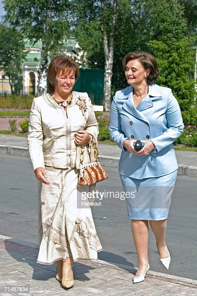 In this handout photo Lyudmila Putin and Cherie Blair arrive at a round table on education involving the G8 leaders' spouses on July 16 2006 in St...