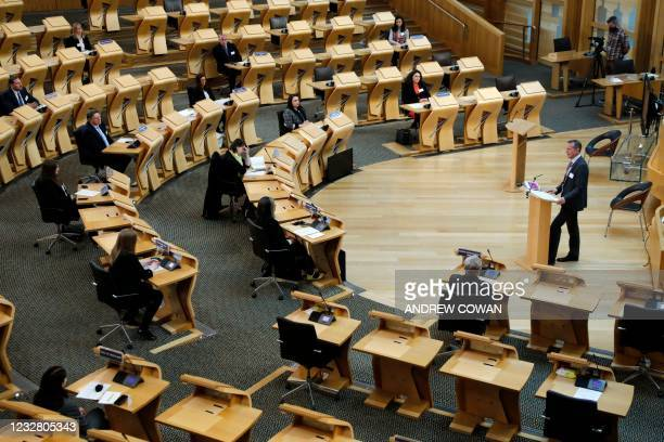 In this handout photo made available from the Scottish Parliament on May 10 newly elected MSPs are welcomed to the Chamber of the Scottish Parliament...