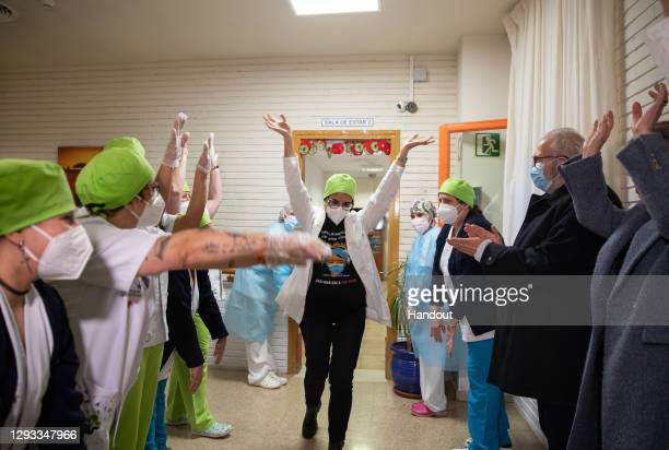 In this handout photo, Maria Carmen Cortés a nurse at the Somontano residence and several health workers celebrate moments after receiving one of the...