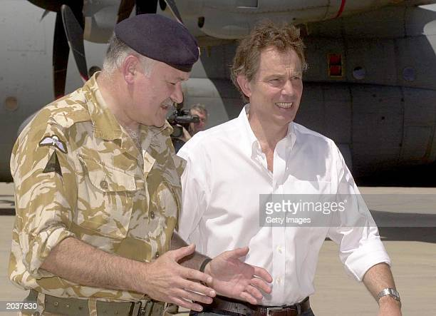 In this handout photo Prime Minister Tony Blair walks with Commander British Forces Major General Peter Wall at Basrah Airport on May 29 2003 in...