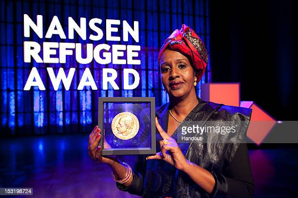 In this handout photo privided by UNHCR Shukri Aden Mohamed accepts UNHCR's 2012 Nansen Refugee Award on behalf of her sister Hawa Aden Mohamed who...