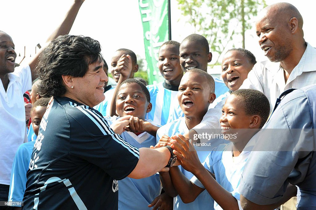 In this handout photo provided by 2010 FIFA World Cup Organising Committee South Africa, Argentina national soccer team's head coach Diego Maradona visits Lowe Middle School on January 19, 2010 in Ga-Rankuwa, South Africa.
