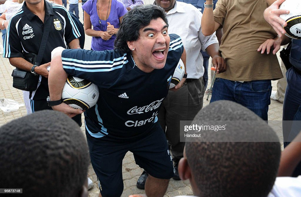 In this handout photo provided by 2010 FIFA World Cup Organising Committee South Africa, Argentina national soccer team's head coach Diego Maradona visits Kgotlelelang School at Winterveldt on January 19, 2010, around 40km north west of Pretoria, South Africa.