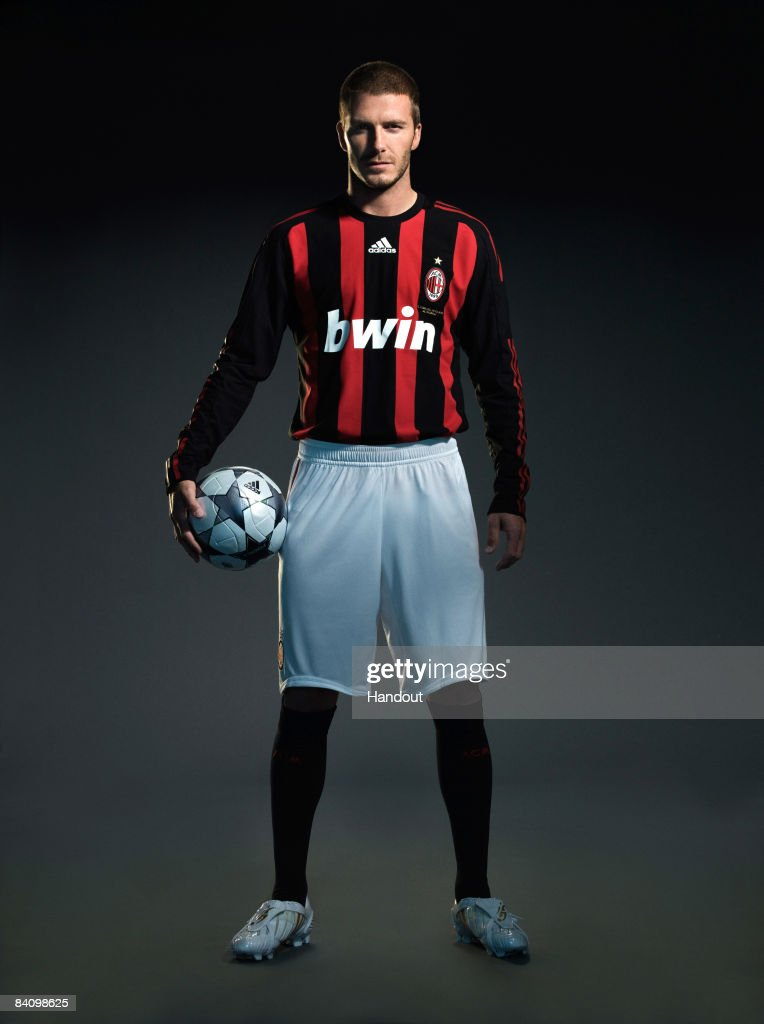In this handout photo provided by adidas, David Beckham of AC Milan reveals his new number 32 shirt before a press conference to announce the start of his loan move to AC Milan from the Los Angeles Galaxy at the Milanello training facility in November, 2008 in Milan, Italy.