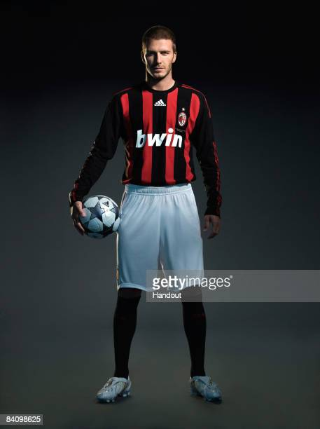 In this handout photo provided by adidas David Beckham of AC Milan reveals his new number 32 shirt before a press conference to announce the start of...