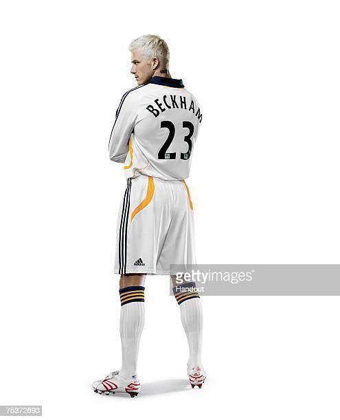In this handout photo provided by Adidas LA Galaxy star signing David Beckham poses wearing his new Galaxy strip on July 11 2007 in Carson California