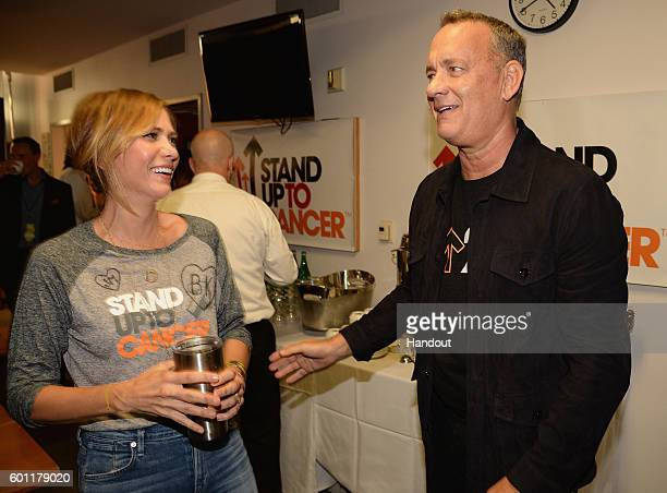 In this handout photo provided by American Broadcasting Companies Inc actors Kristen Wiig and Tom Hanks attend Stand Up To Cancer a program of the...