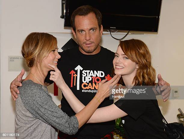 In this handout photo provided by American Broadcasting Companies Inc actors Kristen Wiig Will Arnett and Emma Stone attend Stand Up To Cancer a...