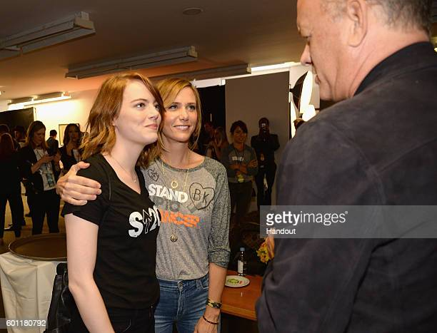 In this handout photo provided by American Broadcasting Companies Inc actors Emma Stone Kristen Wiig and Tom Hanks attend Stand Up To Cancer a...