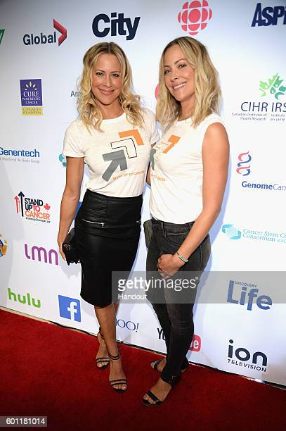 In this handout photo provided by American Broadcasting Companies Inc actresses Brittany Daniel and Cynthia Daniel attend Stand Up To Cancer a...