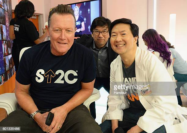 In this handout photo provided by American Broadcasting Companies Inc actors Robert Patrick and Ken Jeong attend Stand Up To Cancer a program of the...