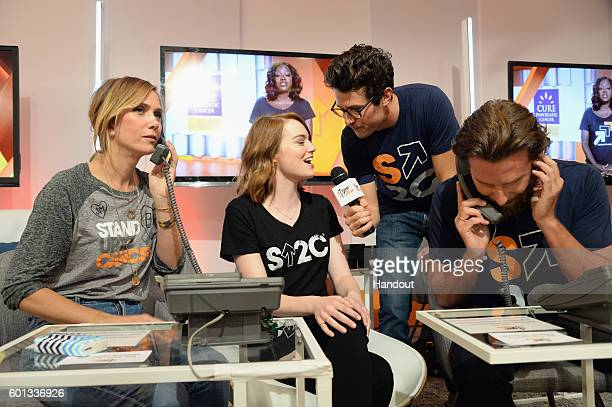 In this handout photo provided by American Broadcasting Companies Inc actors Kristen Wiig and Emma Stone producer Jacob Soboroff and actor Bradley...