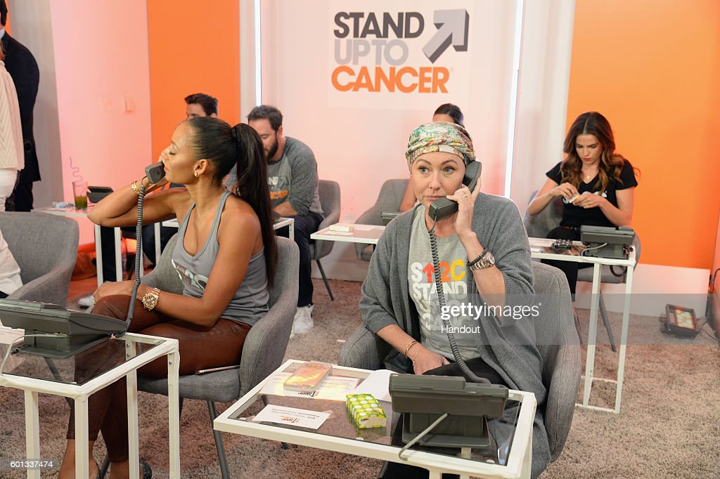 In this handout photo provided by American Broadcasting Companies Inc, singer Mel B (L) and actress Shannen Doherty attend Stand Up To Cancer (SU2C), a program of the Entertainment Industry Foundation (EIF), staging its fifth biennial fundraising telecast at the Walt Disney Concert Hall on Friday September 9, 2016 (8:00-9:00 p.m., ET/PT) in Hollywood California.